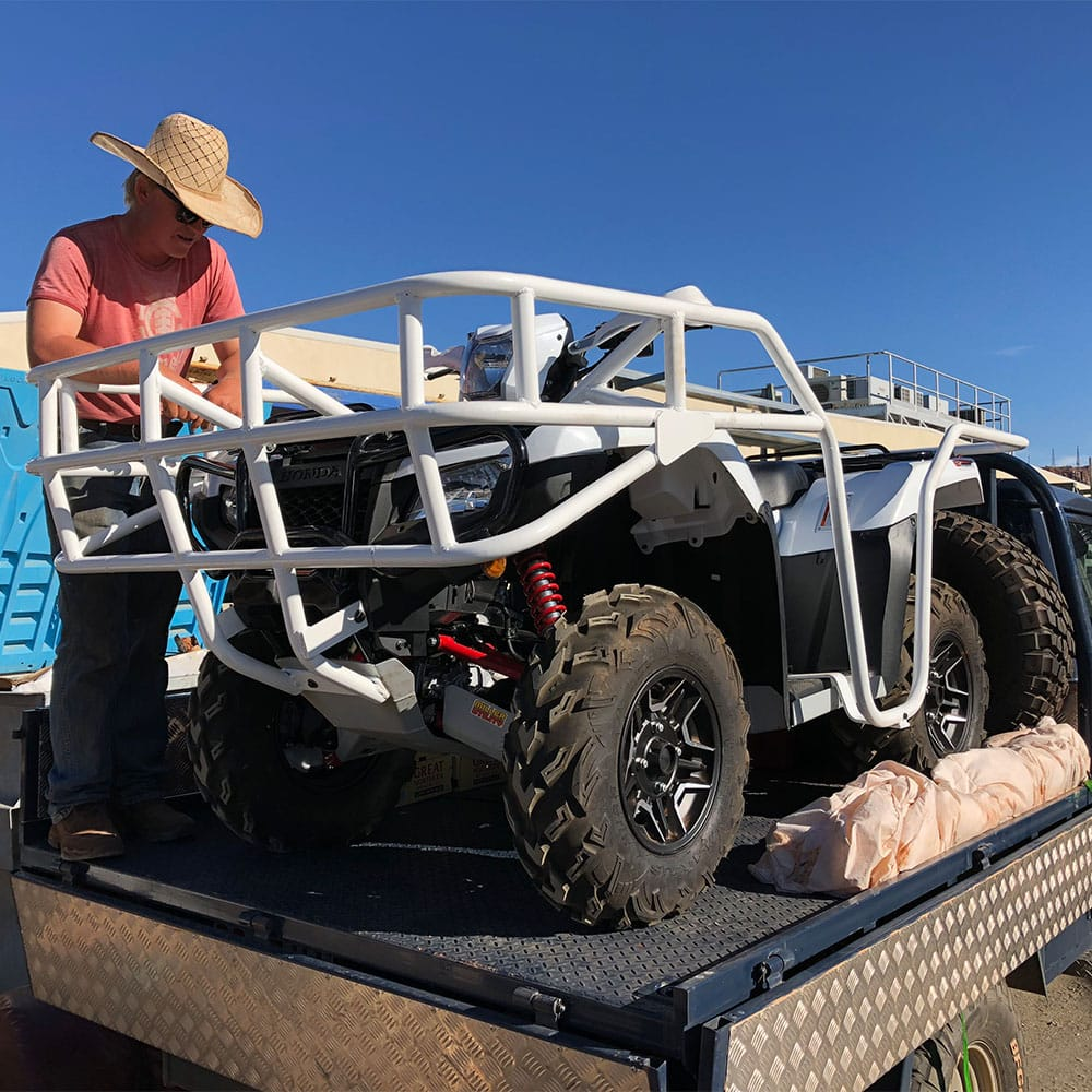 A fabricated steel cage on the back of a vehicle in the Northern Territory