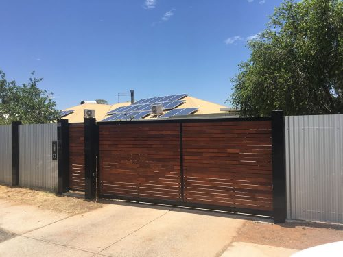 A large custom steel fence on a property in Alice Springs